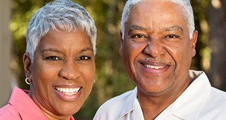 couple wearing collared shirts smiling