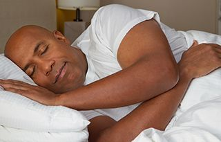 man wearing white shirt sleeping